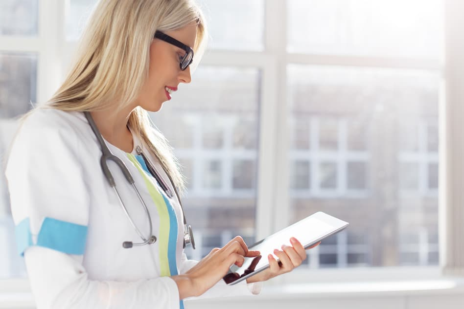 photodune-9680632-female-doctor-looking-at-medical-records-on-ipad-s